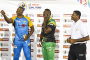 In this handout image provided by CPL T20, Kieron Pollard (L) of St Lucia Stars toss the coin as Andre Russell (C) of Jamaica Tallawahs and match referee Denavon Hayles (R) looks on during match 17 of the Hero Caribbean Premier League between St Lucia Stars and Jamaica Tallawahs at the Darren Sammy Cricket Ground on August 25, 2018 in Gros Islet, Saint Lucia.