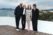"""Luca Guadagnino, Marthe Keller, Julianne Moore and Marco Morabito attend the """"The Staggering Girl"""" Photocall during the 72nd annual Cannes Film Festival on May 17, 2019 in Cannes, France."""