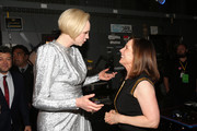 Actor Gwendoline Christie (L) and Producer Kathleen Kennedy at Star Wars: The Last Jedi Premiere at The Shrine Auditorium on December 9, 2017 in Los Angeles, California.