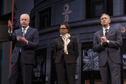 Starbucks CEO Kevin Johnson, left, answers questions during the Starbucks Annual Shareholders Meeting while Starbucks Chief Operating Officer Roz Brewer and Starbucks Executive Chairman Howard Schultz listen at McCaw Hall, on March 21, 2018 in Seattle, Washington. The company announced plans to return $15 billion to shareholders by 2021.