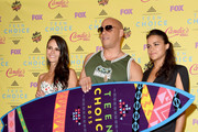 (L-R) Actors Jordana Brewster, Vin Diesel and Michelle Rodriguez,  winners of the Choice Movie: Action Award for Furious 7, pose in the press room during the Teen Choice Awards 2015 at the USC Galen Center on August 16, 2015 in Los Angeles, California.