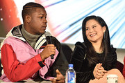 "John Boyega and Kelly Marie Tran participate in the global press conference for ""Star Wars:  The Rise of Skywalker"" at the Pasadena Convention Center on December 04, 2019 in Pasadena, California."