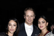 "(L-R) Mishel Prada, Sam Heughan, and Melissa Barrera attend the Starz Premiere event for ""Outlander"" Season 5 at Hollywood Palladium on February 13, 2020 in Los Angeles, California."