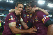 Will Chambers, Greg Inglis and Johnathan Thurston of the Maroons celebrate victory during game one of the State of Origin series between the New South Wales Blues and the Queensland Maroons at ANZ Stadium on May 27, 2015 in Sydney, Australia.