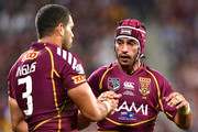 Greg Inglis and Johnathan Thurston of the Maroons celebrate during game two of the ARL State of Origin series between the Queensland Maroons and the New South Wales Blues at Suncorp Stadium on June 26, 2013 in Brisbane, Australia.