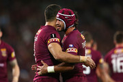 Johnathan Thurston of the Maroons congratulates team mate Greg Inglis of the Maroons after scoring a try during game three of the State of Origin series between the Queensland Maroons and the New South Wales Blues at Suncorp Stadium on July 8, 2015 in Brisbane, Australia.