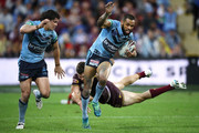 James Roberts of the Blues watches on as Josh Addo-Carr of the Blues beats the tackle of Corey Oates of Queensland during game three of the State of Origin series between the Queensland Maroons and the New South Wales Blues at Suncorp Stadium on July 11, 2018 in Brisbane, Australia.