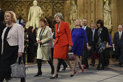 Conservative MP Theresa May (C) walks with Members of Parliament through the Central Lobby toward the House of Lords to listen to the Queen's Speech during the State Opening of Parliament at the Palace of Westminster on October 14, 2019 in London, England. The Queen's speech is expected to announce plans to end the free movement of EU citizens to the UK after Brexit, new laws on crime, health and the environment.