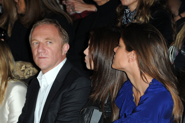 Charlotte Casiraghi (L-R) Francois-Henri Pinault, Dasha Zhukova and Charlotte Casiraghi, attend the Stella McCartney Pret a Porter show as part of the Paris Womenswear Fashion Week Spring/Summer 2010 at Palais De Tokyo on October 5, 2009 in Paris, France.