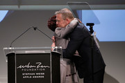 Sheila Johnson and honoree Joel Towers embrace onstage during the Stephan Weiss Apple Awards at Urban Zen on October 24, 2018 in New York City.