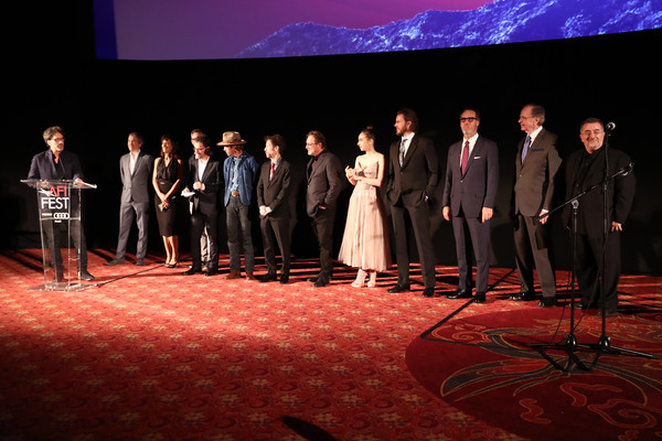'The Ballad Of Buster Scruggs' AFI Gala [event,stage,performance,sky,heater,scene,drama,theatre,performing arts,musical theatre,afi gala,l-r,the ballad of buster scruggs,joel coen,carter burwell,tim blake nelson,stephen root,zoe kazan,mary zophres,willie watson]