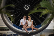 Steven and Alex Gerrard pose for a picture on a BA777 aircraft to launch British Airways Caribbean Campaign at Heathrow Airport on May 11, 2015 in London, England. Alex is wearing a dress by Isabel Marant and Kurt Geiger espadrilles, Steven wears shorts by Lanvin and a shirt by Orlebar Brown