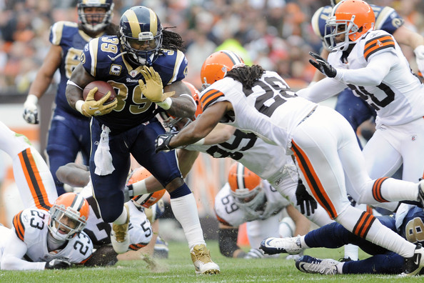 Steven Jackson stiff-arms Usama Young. Photo by Jason Miller/Getty Images