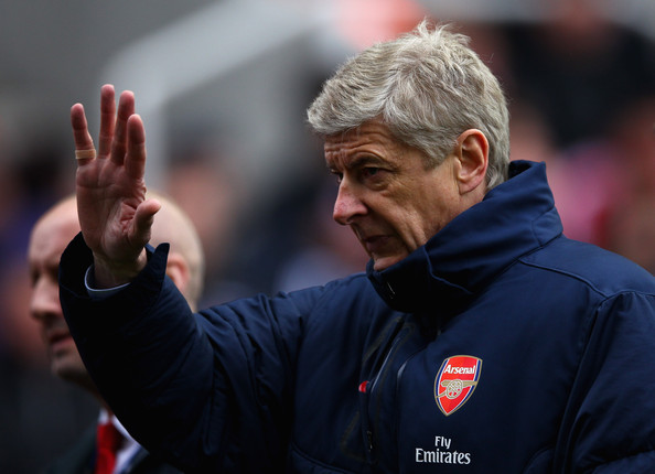 Arsenal manager Arsene Wenger waves at the crowd during the Barclays Premier League match between Stoke City and Arsenal at Britannia Stadium on April 28, 2012 in Stoke on Trent, England.
