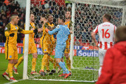 Mathew Ryan of Brighton and Hove Albion is congratulated by team mates after saving a penalty from Charlie Adam of Stoke City during the Premier League match between Stoke City and Brighton and Hove Albion at Bet365 Stadium on February 10, 2018 in Stoke on Trent, England.