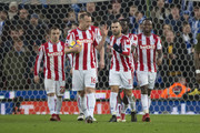 Stoke City players encourage Charlie Adam of Stoke City prior to taking a penalty during the Premier League match between Stoke City and Brighton and Hove Albion at Bet365 Stadium on February 10, 2018 in Stoke on Trent, England.