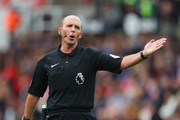 Referee Mike Dean gestures during the Premier League match between Stoke City and Chelsea at Bet365 Stadium on September 23, 2017 in Stoke on Trent, England.