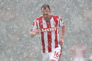 Charlie Adam of Stoke City leaves the pitch following being shown a red card during the Premier League match between Stoke City and Everton at Bet365 Stadium on March 17, 2018 in Stoke on Trent, England.