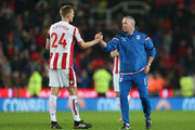 Paul Lambert, Manager of Stoke City shakes hands with Darren Fletcher following the Premier League match between Stoke City and Huddersfield Town at Bet365 Stadium on January 20, 2018 in Stoke on Trent, England.
