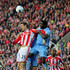 Peter Crouch Photos - (L-R) Peter Crouch of Stoke competes with Kolo Toure of Manchester City for a header during the Barclays Premier League match between Stoke City and Manchester City at the Britannia Stadium on March 24, 2012 in Stoke on Trent, England. - Stoke City v Manchester City - Premier League