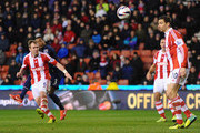 Patrice Evra of Manchester United scores his team's second goal during the Capital One Cup Quarter Final match between Stoke City and Manchester United at the Britannia Stadium on December 18, 2013 in Stoke on Trent, England.