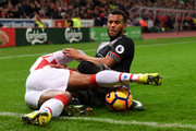 Glen Johnson of Stoke City (L) tackles Ryan Bertrand of Southampton (R) during the Premier League match between Stoke City and Southampton at Bet365 Stadium on December 14, 2016 in Stoke on Trent, England.