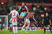Marko Arnautovic of West Ham United is challenged by Darren Fletcher of Stoke City during the Premier League match between Stoke City and West Ham United at Bet365 Stadium on December 16, 2017 in Stoke on Trent, England.
