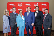 """Secretary of the Agency for Health Care Administration Mary Mayhew, AARP Florida State Director Jeff Johnson, AARP CEO Jo Ann Jenkins, Florida Governor Ron DeSantis, Florida Senator Aaron Bean and Florida Representative John Leek, pose for a photo before taking the stage for the first of a series of """"u201cWe Hear You""""u201d Town Halls to hear from older Americans about how the high cost of prescription drugs is affecting them at Florida State University""""u2019s Turnbull Conference Center on April 23, 2019 in Tallahassee, Florida."""