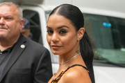 Actress Vanessa Hudgens is seen wearing a gold sequence dress a gray fur coat and black ankle boots to the Vera Wang show part of New York Fashion Week at the The American Stock Exchange Building on September 10, 2019 in New York City.