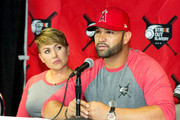 (L-R) Deidre Pujols and Albert Pujols attend the Strike Out Slavery Press Conference at Angel Stadium on August 9, 2018 in Anaheim, California.