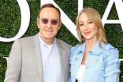 Actor Kevin Spacey and Chairman and President of The Stronach Group Belinda Stronach arrive at The Stronach Group Owner's Chalet at 142nd Preakness Stakes at Pimlico Race Course on May 20, 2017 in Baltimore, Maryland.