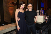 Camilla Belle (L) and Stuart Weitzman Creative Director Giovanni Morelli attend the Stuart Weitzman FW18 Presentation and Cocktail Party at The Pool on February 8, 2018 in New York City.