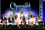 """(Top L-R) Jessica O'Toole, Jennie Snyder Urman, Amy Rardin (Bottom L-R) Ellen Tamaki, Rupert Evans, Sarah Jeffery, Melonie Diaz, Madeleine Mantock, and Ser'Darius Blain from """"Charmed"""" speaks onstage at the CW Network portion of the Summer 2018 TCA Press Tour at The Beverly Hilton Hotel on August 6, 2018 in Beverly Hills, California."""