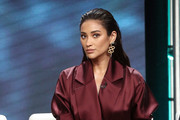 """Actress Shay Mitchell of the television show """"You"""" speaks during the A&E segment of the Summer 2018 Television Critics Association Press Tour at the Beverly Hilton Hotel on July 26, 2018 in Beverly Hills, California."""