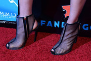 Actress Maggie Q (shoes detail) arrives at Summit Entertainment's press event for the movies 'Ender's Game' and 'Divergent' at the Hard Rock Hotel San Diego on July 18, 2013 in San Diego, California.