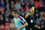 Joey Barton of Burnley is shown a yellow card by referee Robert Madley during the Premier League match between Sunderland and Burnley at Stadium of Light on March 18, 2017 in Sunderland, England.