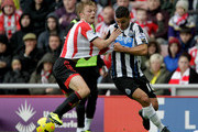 Sebastian Larsson of Sunderland in action against Hatem Ben Arfa of Newcastle during the Barclays Premier League match between Sunderland and Newcastle United at Stadium of Light on October 27, 2013 in Sunderland, England.