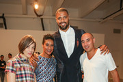 (L-R) Designer Erin Beatty, Kimberly Chandler, NBA player Tyson Chandler and Max Osterweis pose backstage at the Suno fashion show during MADE Fashion Week Spring 2014 at Center 548 on September 6, 2013 in New York City.
