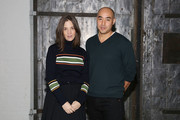 Fashion designers Erin Beatty and Max Osterweis pose backstage at Suno runway show during Mercedes-Benz Fashion Week Fall 2015 at Center 548 on February 13, 2015 in New York City.