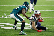 Chris Hogan #15 of the New England Patriots is tackled by Patrick Robinson #21 of the Philadelphia Eagles during the second quarter in Super Bowl LII at U.S. Bank Stadium on February 4, 2018 in Minneapolis, Minnesota.