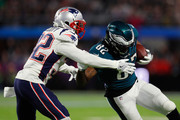Devin McCourty #32 of the New England Patriots makes the tackle attempt on Torrey Smith #82 of the Philadelphia Eagles during the fourth quarter in Super Bowl LII at U.S. Bank Stadium on February 4, 2018 in Minneapolis, Minnesota.