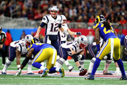 Tom Brady #12 of the New England Patriots calls a play during Super Bowl LIII against the Los Angeles Rams at Mercedes-Benz Stadium on February 03, 2019 in Atlanta, Georgia.