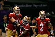 Frank Gore #21 of the San Francisco 49ers celebrates with teammates Colin Kaepernick #7 and  Joe Staley #74 after scoring a touchdown in the third quarter against the Baltimore Ravens during Super Bowl XLVII at the Mercedes-Benz Superdome on February 3, 2013 in New Orleans, Louisiana.