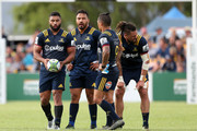 Lima Sopoaga (L) of the Highlanders prepares to take a kick as team mates Ash Dixon, Aaron Smith and Elliot Dixon look on during the Super Rugby trial match between the Highlanders and the Crusaders at Fred Booth Park on February 15, 2018 in Waimumu, New Zealand.