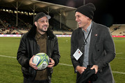 Celebrity magician Dynamo (L) talks to All Blacks and Crusaders player Israel Dagg (R) prior to the Super Rugby Qualifying Final match between the Crusaders and the Sharks at AMI Stadium on July 21, 2018 in Christchurch, New Zealand.
