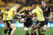 Liam Messam of the Chiefs is tackled by TJ Perenara   during the Super Rugby Qualifying Final match between the Hurricanes and the Chiefs at Westpac Stadium on July 20, 2018 in Wellington, New Zealand.
