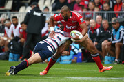 Robbie Fruean of the Crusaders is tackled by Mike Harris of the Rebels during the round one Super Rugby match between the Crusaders and the Rebels at AMI Stadium on February 13, 2015 in Christchurch, New Zealand.