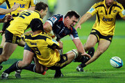 Nic Henderson of the Rebels loses the ball in the tackle of Victor Vito of the Hurricanes during the round 14 Super Rugby match between the Hurricanes and the Melbourne Rebels at Westpac Stadium on May 26, 2012 in Wellington, New Zealand.
