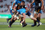 Scott Scrafton of the Blues is tackled by Liam Messam of the Chiefs during the round two Super Rugby match between the Blues and the Chiefs at Eden Park on March 2, 2018 in Auckland, New Zealand.