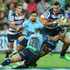 Bernard Foley Jack Debreczeni Photos - Jack Debreczeni of the Rebels is tackled by Bernard Foley of the Waratahs tackle during the round two Super Rugby match between the Rebels and the Waratahs at AAMI Park on February 20, 2015 in Melbourne, Australia. - Bernard Foley Jack Debreczeni Photos - 2 of 4